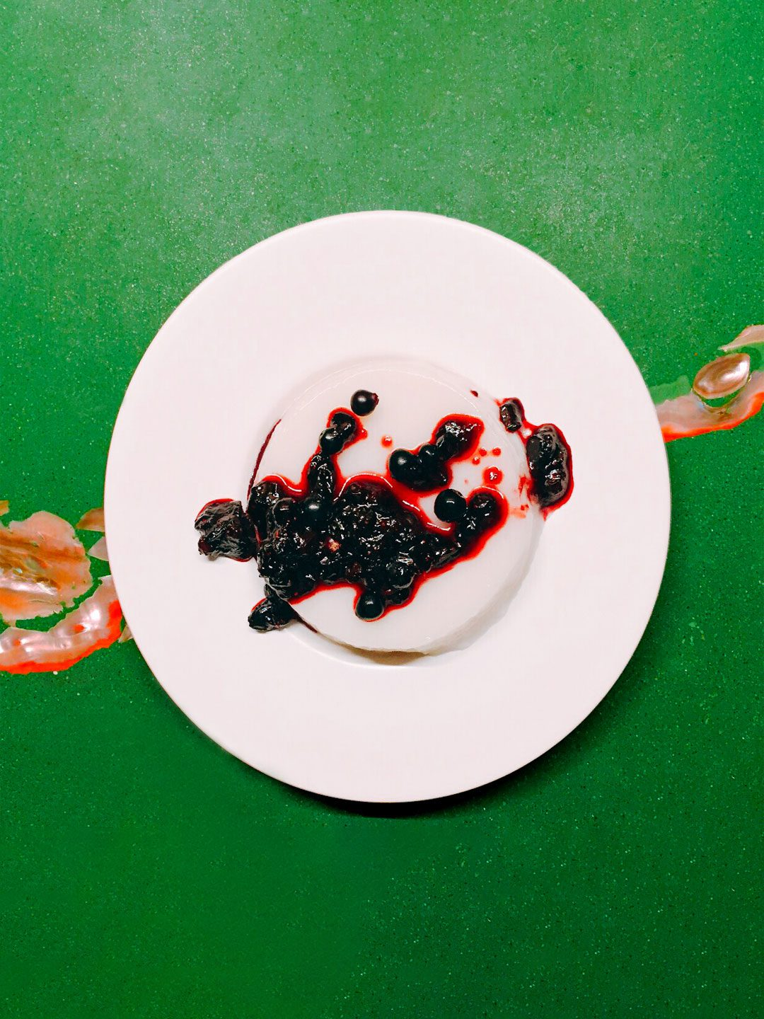 Coconut-Cardamom Panna Cotta with Huckleberry-Maple Sauce